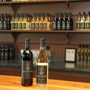 2 of Harvest Ridge's award winning wines: Merlot and Pinot Gris